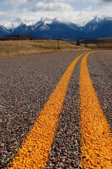 The road leading to the Mission Mountains, St. Ignacious, MT. Photograph by Jay Combs.
